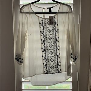 White and black print shirt
